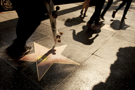 Pedestrians pass Alfred Hitchcock's star on the Walk of Fame in Hollywood, California, U.S. on Friday, July 22, 2011. Los Angeles, which is selling $380 million in debt, may benefit from demand for California bonds with long-term issuance at the lowest since 2000. Photographer: Konrad Fiedler/Bloomberg via Getty Images