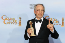 "BEVERLY HILLS, CA - JANUARY 15:  Director/producer Steven Spielberg poses in the press room with the Best Animated Film award for ""The Adventures of Tintin"" at the 69th Annual Golden Globe Awards held at the Beverly Hilton Hotel on January 15, 2012 in Beverly Hills, California.  (Photo by Kevin Winter/Getty Images)"