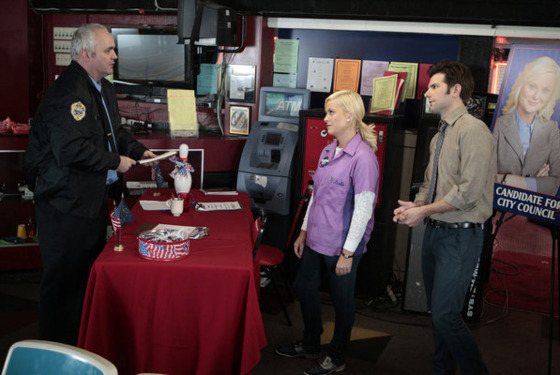"PARKS AND RECREATION -- ""Bowling for Votes"" Episode 413 -- Pictured: (l-r) Will McLaughlin as officer, Amy Poehler as Leslie Knope, Adam Scott as Ben Wyatt -- Photo by: Chris Haston/NBC"