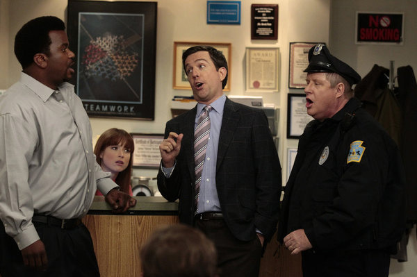 "THE OFFICE -- ""Jury Duty"" Episode 813 -- Pictured: (l-r) Craig Robinson as Darryl Philbin, Ellie Kemper as Kelly Erin Hannon, Ed Helms as Andy Bernard, Michael ""Tuba"" Henderson as policeman."
