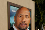 LOS ANGELES, CA - FEBRUARY 02:  Actor Dwayne Johnson arrives at the premiere of Warner Bros. Pictures' &quot;Journey 2: The Mysterious Island&quot; at the Chinese Theater on February 2, 2012 in Los Angeles, California.  (Photo by Kevin Winter/Getty Images)