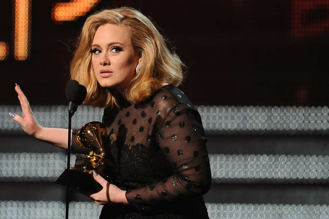 Singer Adele speaks after receiving her Grammy award at the Staples Center during the 54th Grammy Awards in Los Angeles, California, February 12, 2012. AFP PHOTO  Robyn BECK (Photo credit should read ROBYN BECK/AFP/Getty Images)