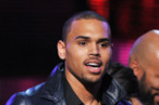 LOS ANGELES, CA - FEBRUARY 12:  Singer Chris Brown accepts the award for 'Best Rap Performance' onstage at the 54th Annual GRAMMY Awards held at Staples Center on February 12, 2012 in Los Angeles, California.  (Photo by Kevin Winter/Getty Images)