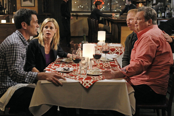 "MODERN FAMILY - ""Aunt Mommy"" - After closing on the sale of a house to Mitch and Cam's friends, Phil and Claire take the two of them out for a celebratory dinner where they proceed to over-indulge in drinks, which leads to some over-sharing, and finally results in waking up the next morning hung over and begging the question - if you'll do anything for family, shouldn't there still be a line drawn somewhere? -- on ""Modern Family,"" WEDNESDAY, FEBRUARY 15 (9:00-9:31 p.m., ET), on the ABC Television Network. (ABC/PETER ""HOPPER"" STONE) TY BURRELL, JULIE BOWEN, JESSE TYLER FERGUSON, ERIC STONESTREET"