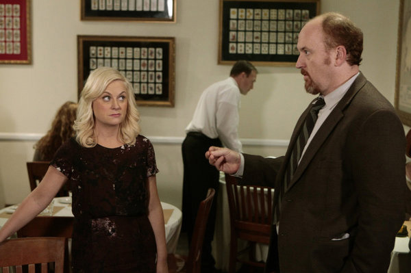 "PARKS AND RECREATION -- ""Dave Returns"" Episode 415 -- Pictured: (l-r) Amy Poehler as Leslie Knope, Louis C.K. as Dave Sanderson."