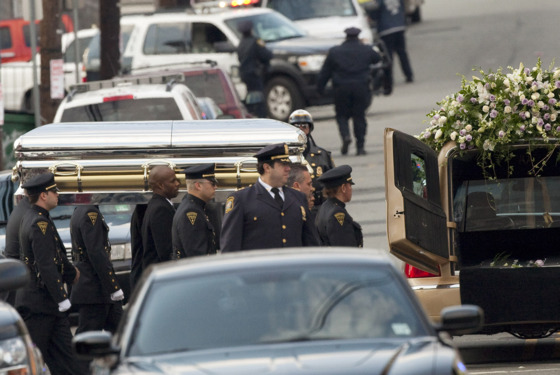 NEWARK, NJ - FEBRUARY 18:  Pallbearers carry the casket of Whitney Houston to a hearse outside New Hope Baptist Church after funeral services on February 18, 2012 in Newark, New Jersey. Whitney Houston was found dead in her hotel room at The Beverly Hilton hotel on Febr