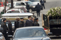 NEWARK, NJ - FEBRUARY 18:  Pallbearers carry the casket of Whitney Houston to a hearse outside New Hope Baptist Church after funeral services on February 18, 2012 in Newark, New Jersey. Whitney Houston was found dead in her hotel room at The Beverly Hilton hotel on February 11, 2012. (Photo by Michael Nagle/Getty Images)
