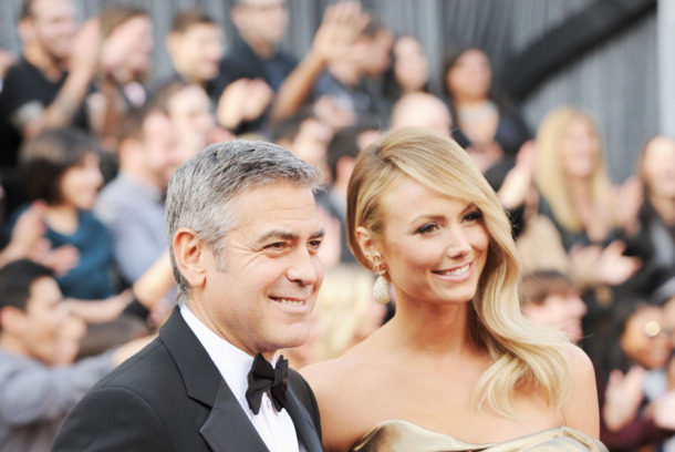 HOLLYWOOD, CA - FEBRUARY 26:  Actor George Clooney (L) and Stacy Kiebler arrive at the 84th Annual Academy Awards held at the Hollywood & Highland Center on February 26, 2012 in Hollywood, California.  (Photo by Jason Merritt/Getty Images)