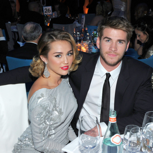Singer Miley Cyrus and actor Liam Hemsworth attend the 20th Annual Elton John AIDS Foundation Academy Awards Viewing Party at The City of West Hollywood Park on February 26, 2012 in Beverly Hills, California.