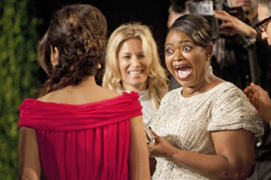 Oscar winner Octavia Spencer (R) reacts to seeing Salma Hayek on the carpet as they arrive at the Vanity Fair Oscar Party for the 84th Annual Academy Awards at the Sunset Tower on February 26, 2012 in West Hollywood, California.AFP PHOTO / ADRIAN SANCHEZ-GONZALEZ (Photo credit should read ADRIAN SANCHEZ-GONZALEZ/AFP/Getty Images)