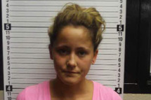 "OAK ISLAND, NC - AUGUST 08:  In this booking photo provided by the the Brunswick County Sheriff's Department, Jenelle Evans poses for a mug shot August 8, 2011 in Oak Island, North Carolina.  Evans, of MTV's ""Teen Mom 2"", was arrested Monday for violating the terms of her probation after testing possitive for Marijuanna and opiates.  Evans was placed in jail on USD 10,000 bond and later released.  (Photo by Brunswick County Sheriff's Department via Getty Images)"