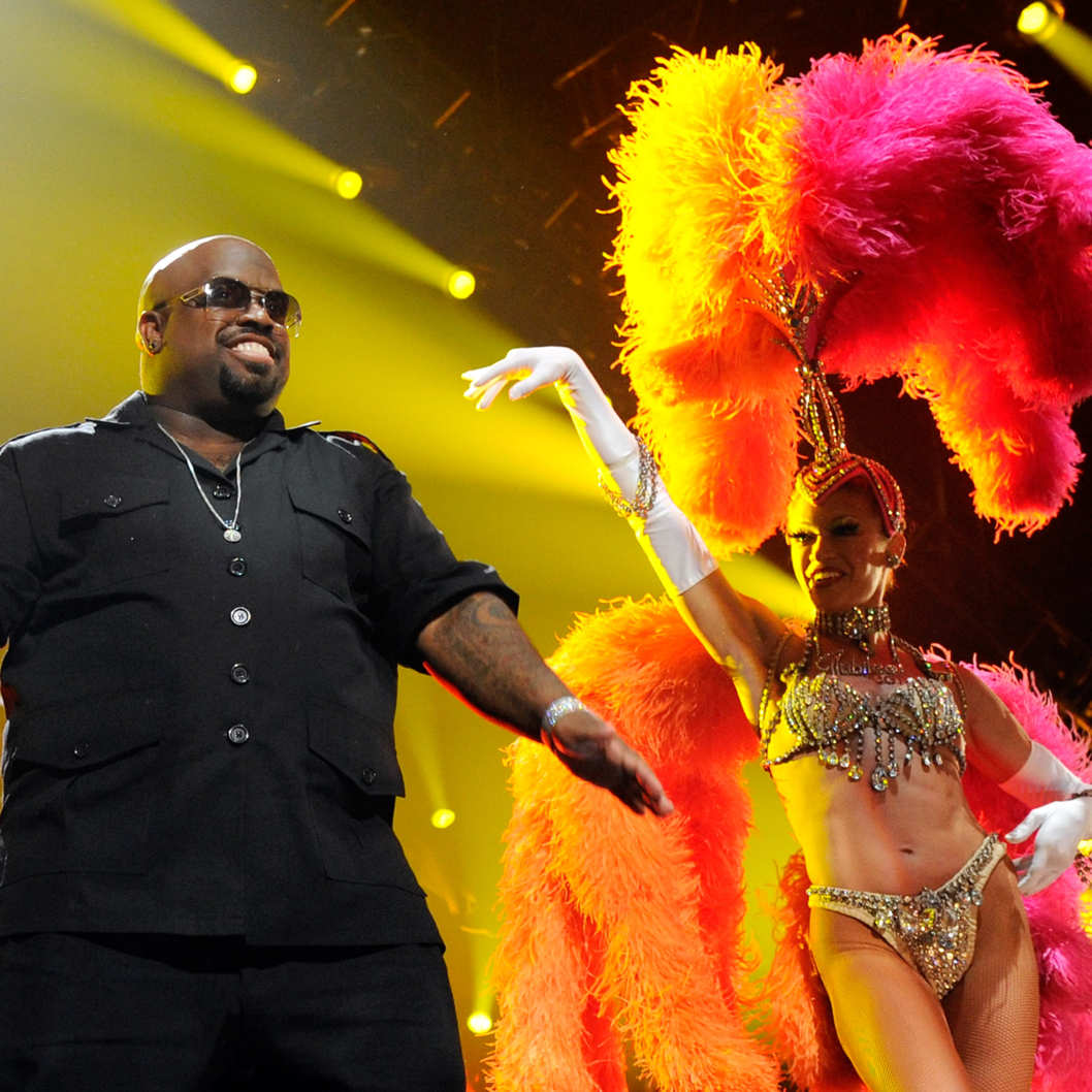"LAS VEGAS, NV - FEBRUARY 18:  (EXCLUSIVE COVERAGE)  Recording artist Cee Lo Green (L) performs with a showgirl from the Jubilee! production show at the Keep Memory Alive foundation's ""Power of Love Gala"" celebrating Muhammad Ali's 70th birthday at the MGM Grand Garden Arena February 18, 2012 in Las Vegas, Nevada. The event benefits the Cleveland Clinic Lou Ruvo Center for Brain Health and the Muhammad Ali Center.  (Photo by Ethan Miller/Getty Images for Keep Memory Alive)"
