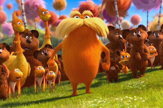 "The Lorax (DANNY DEVITO) stands with the Bar-ba-loots, Swomee-Swans and Humming-Fish in ""Dr. Seuss' The Lorax""."