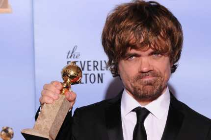 The winner for Best Performance by an Actor in a Supporting Role in a Series, Mini-Series or Motion Picture Made for Television Peter Dinklage poses with the trophy at the 69th annual Golden Globe Awards at the Beverly Hilton Hotel in Beverly Hills, California, January 15, 2012. AFP PHOTO / Robyn BECK (Photo credit should read ROBYN BECK/AFP/Getty Images)