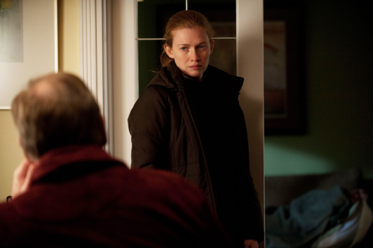 Lt. Michael Oakes (Garry Chalk) and Sarah Linden (Mireille Enos) - The Killing - Season 2, Episode 1 - Photo credit: Carole Segal/AMC