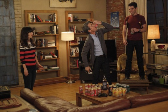 NEW GIRL:  The gang plays drinking games when Jess (Zooey Deschanel, L) invites Russell (guest star Dermot Mulroney, C) to spend the weekend at the loft i