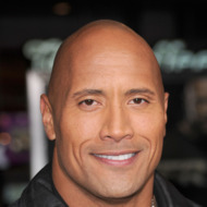 "HOLLYWOOD - NOVEMBER 22:  Actor Dwayne Johnson arrives at the ""Faster"" Los Angeles Premiere at Grauman's Chinese Theatre on November 22, 2010 in Hollywood, California.  (Photo by Jason Merritt/Getty Images) *** Local Caption *** Dwayne Johnson"