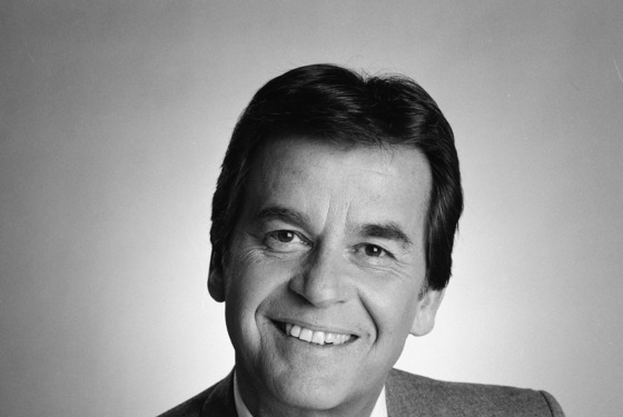 Headshot studio portrait of American television host, producer, and actor Dick Clark, dressed in a blazer and tie, February 25, 1985. (Photo by CBS Photo Archive/Getty Images)