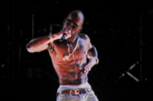 INDIO, CA - APRIL 15:  A holographic image of Tupac Shakur is seen performing during day 3 of the 2012 Coachella Valley Music & Arts Festival at the Empire Polo Field on April 15, 2012 in Indio, California.  (Photo by Kevin Winter/Getty Images for Coachella)
