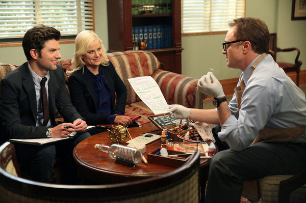 "PARKS AND RECREATION -- ""Live Ammo"" Episode 419 -- Pictured: (l-r) Adam Scott as Ben Wyatt, Amy Poehler as Leslie Knope, Bradley Whitford as Councilman Pillner -- (Photo by: Danny Feld/NBC)"