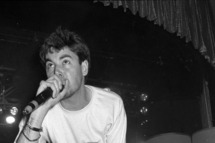 MCA (Adam Yauch) of the hip hop group the Beastie Boys performs live on February 2, 1987 in Los Angeles, California.