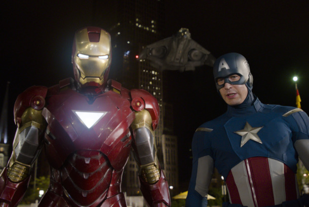 """Marvel's The Avengers""  L to R: Iron Man (Robert Downey Jr.) and Captain America (Chris Evans) with the Quinjet in background  Ph: Film Frame   © 2011 MVLFFLLC.  TM & © 2011 Marvel.  All Rights Reserved."