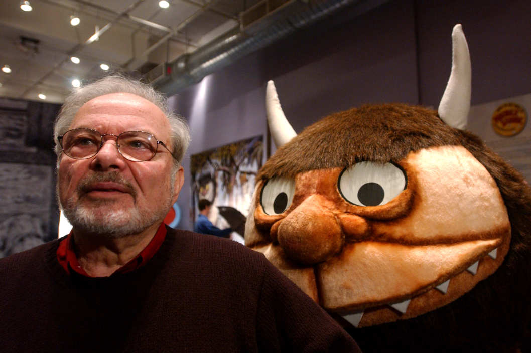"Standing with a character from his book ""Where the Wild Things Are,"" author and illustrator Maurice Sendak"