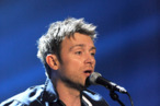 LONDON, ENGLAND - FEBRUARY 21:  (EMBARGOED FOR PUBLICATION IN UK TABLOID NEWSPAPERS UNTIL 48 HOURS AFTER CREATE DATE AND TIME. MANDATORY CREDIT PHOTO BY DAVE M. BENETT/GETTY IMAGES REQUIRED)  Damon Albarn of Blur performs during a dress rehearsal at the BRIT Awards 2012 held at O2 Arena on February 21, 2012 in London, England.  (Photo by Dave M. Benett/Getty Images)