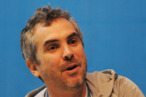Mexican director Alfonso Cuaron adresses the audience during a meeting with young people in the sidelines of the XVIII Ibero American Summit in San Salvador on October 30, 2008. Leaders from Spain, Portugal and Latin America seek to present a joint statement at a meeting of the Group of Twenty (G20) leaders on the global financial crisis in Washington on November 15.    AFP PHOTO MIGUEL ALVAREZ (Photo credit should read MIGUEL ALVAREZ/AFP/Getty Images)
