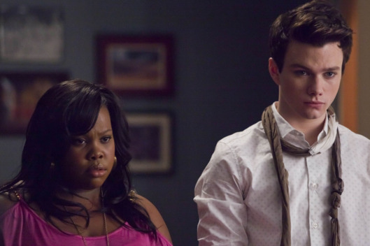 "GLEE: Mercedes (Amber Riley, L) and Kurt (Chris Colfer, R) listen to Sue's plans in the first hour of a special two-hour ""Props/Nationals"" episode of GLEE airing Tuesday, May 15 (8:00-10:00 PM ET/PT) on FOX."