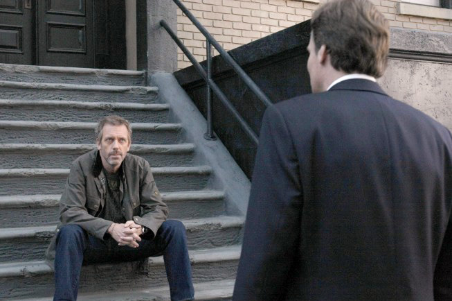 HOUSE:  House (Hugh Laurie, L) has some news for Wilson (Robert Sean Leonard, R)