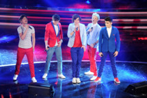 One Direction performs on stage at the fourth day of the 62th Sanremo Song Festival