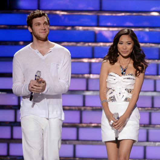 "Finalists Phillip Phillips and Jessica Sanchez walk onstage during Fox's ""American Idol 2012"" results show"