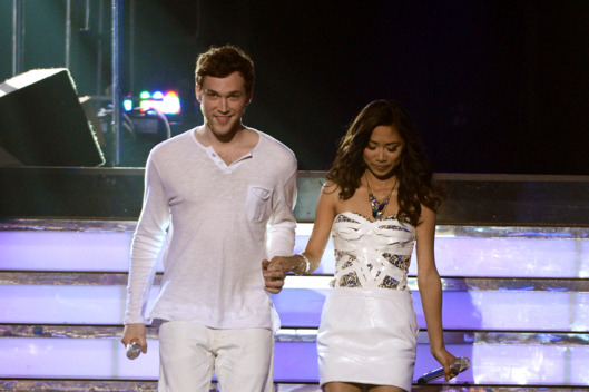 "Finalists Phillip Phillips and Jessica Sanchez walk onstage during Fox's ""American Idol 2012"" results show at Nokia Theatre L.A. Live on May 23, 2012 in Los Angeles, California."