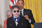 US President Barack Obama presents the Presidential Medal of Freedom to musician Bob Dylan during a ceremony on May 29, 2012 in the East Room of the White House in Washington. The award is the country's highest civilian honor.    AFP PHOTO/Mandel NGAN        (Photo credit should read MANDEL NGAN/AFP/GettyImages)