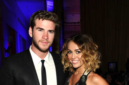Actress/singer Miley Cyrus and Liam Hemsworth backstage during Muhammad Ali's Celebrity Fight Night XVIII held at JW Marriott Desert Ridge Resort & Spa on March 24, 2012 in Phoenix, Arizona.