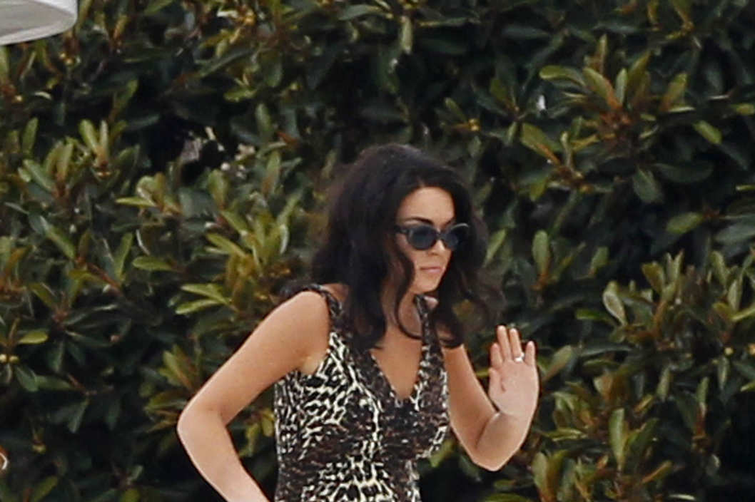 Lindsay Lohan bares all in a leopard print one-piece during filming for 'Liz & Dick'.  Lohan filmed scenes on a luxury boat in Marina Del Rey harbor for the upcoming TV movie in which she stars as Liz Taylor.