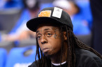 OKLAHOMA CITY, OK - JUNE 12:  Rapper Lil Wayne sits courtside during halftime as the Oklahoma City Thunder take on the Miami Heat in Game One of the 2012 NBA Finals at Chesapeake Energy Arena on June 12, 2012 in Oklahoma City, Oklahoma. NOTE TO USER: User expressly acknowledges and agrees that, by downloading and or using this photograph, User is consenting to the terms and conditions of the Getty Images License Agreement.  (Photo by Ronald Martinez/Getty Images)