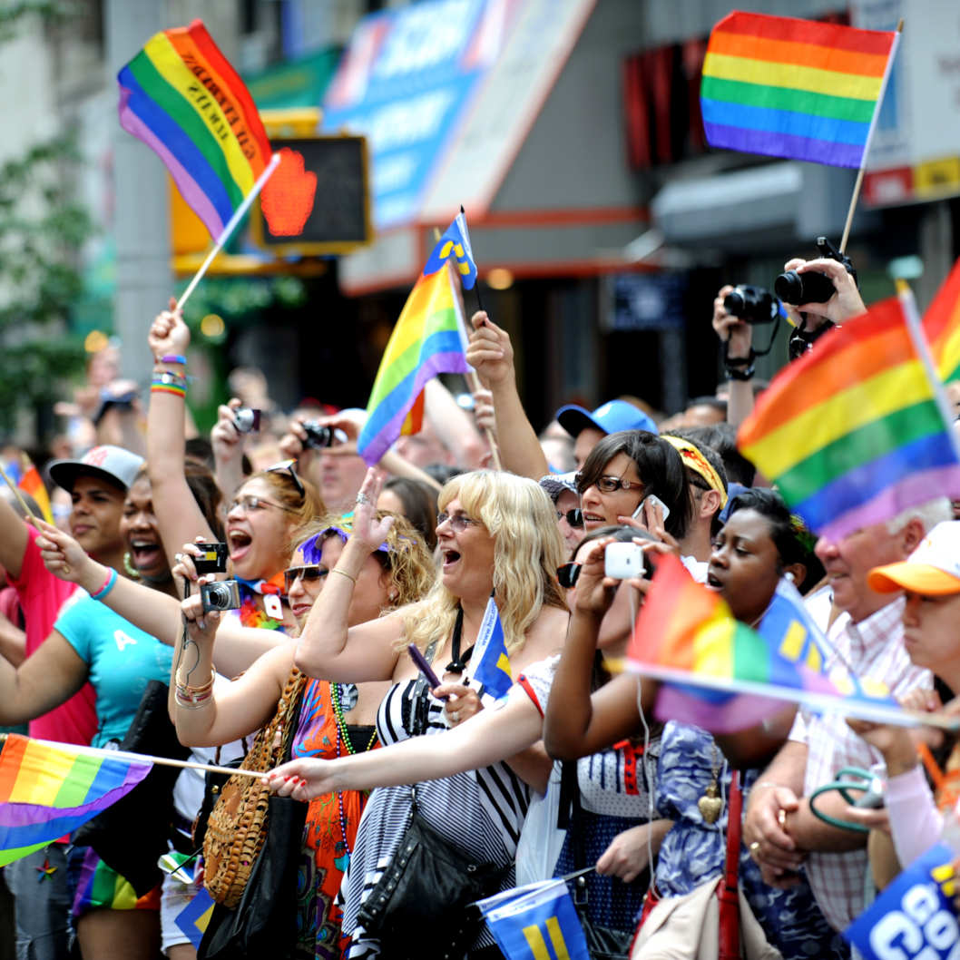 Spectators cheer during the New York City gay pride march June 26, 2011.