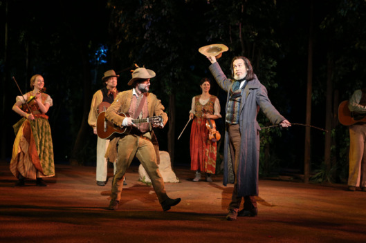 Jordan Tice and Stephen Spinella (foreground) in the Shakespeare in the Park production of As You Like It, directed by Daniel Sullivan, running as part of The Public Theater's Shakespeare in the Park