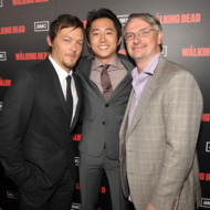 "LOS ANGELES, CA - OCTOBER 03:  Norman Reedus, Steven Yeun, and Glen Mazzara attend the premiere of AMC's ""The Walking Dead"" Season 2 at Regal Cinemas L.A. Live on October 3, 2011 in Los Angeles, California.  (Photo by John Shearer/WireImage)"