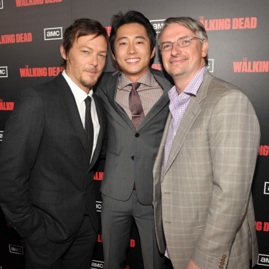 "Norman Reedus, Steven Yeun, and Glen Mazzara attend the premiere of AMC's ""The Walking Dead"" Season 2 at Regal Cinemas L.A. Live on October 3, 2011 in Los Angeles, California."