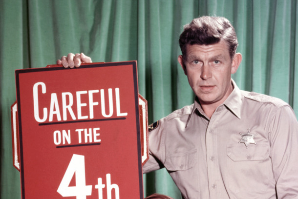 Andy Griffith, US actor, and Ron Howard, US actor, pose beside a large firework, with a sign reading 'Careful on the 4th' in a publicity portrait issued for the US television series, 'The Andy Griffith Show', USA, circa 1963. The sitcom starred  (Photo by Silver Screen Collection/Getty Images)