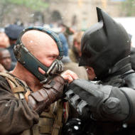 (L-r) TOM HARDY as Bane and CHRISTIAN BALE as Batman in Warner Bros. Pictures&rsquo; and Legendary Pictures&rsquo; action thriller &ldquo;THE DARK KNIGHT RISES,&rdquo; a Warner Bros. Pictures release. TM and &copy; DC Comics