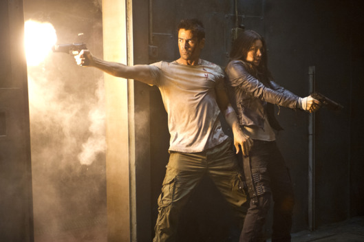 Colin Farrell (left) and Jessica Biel star in Columbia Pictures' action thriller TOTAL RECALL.