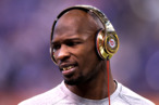 INDIANAPOLIS, IN - FEBRUARY 05:  Chad Ochocinco #85 of the New England Patriots waits on the field during warmups before the New England Patriots take on the New York Giants in Super Bowl XLVI at Lucas Oil Stadium on February 5, 2012 in Indianapolis, Indiana.  (Photo by Elsa/Getty Images)