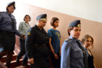 "Members of the all-girl punk band ""Pussy Riot"" Nadezhda Tolokonnikova (C), Maria Alyokhina (R) and Yekaterina Samutsevich (L) are escorted by plicewomen inside a court building in Moscow on Agust 17, 2012. A Moscow court will pass judgement Friday on three women from a tiny punk band who captured global attention by defying the Russian authorities and ridiculing President Vladimir Putin in a church. Pussy Riot release rallies have stretched from Sydney to New York as a growing list of celebrities joined ex-Beatle Paul McCartney and pop icon Madonna in a campaign directed against Putin's crackdown on most dissent. AFP PHOTO / NATALIA KOLESNIKOVA        (Photo credit should read NATALIA KOLESNIKOVA/AFP/GettyImages)"