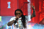HOLLYWOOD, CA - MARCH 01:  Rapper Lil Wayne performs onstage at Escape to Total Rewards at at Hollywood &amp; Highland Center on March 1, 2012 in Hollywood, California.  (Photo by Mark Davis/Getty Images for  Caesars Entertainment)