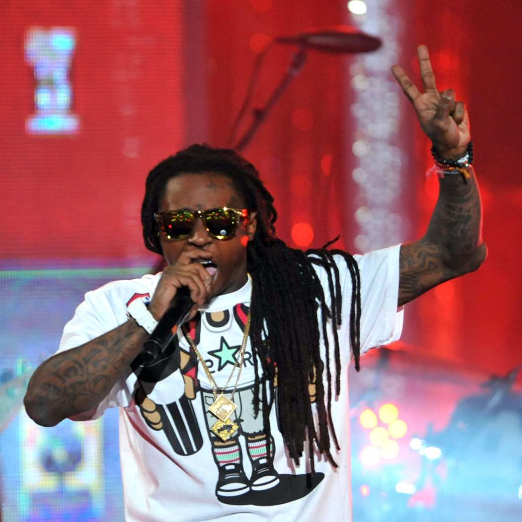 HOLLYWOOD, CA - MARCH 01:  Rapper Lil Wayne performs onstage at Escape to Total Rewards at at Hollywood & Highland Center on March 1, 2012 in Hollywood, California.  (Photo by Mark Davis/Getty Images for  Caesars Entertainment)