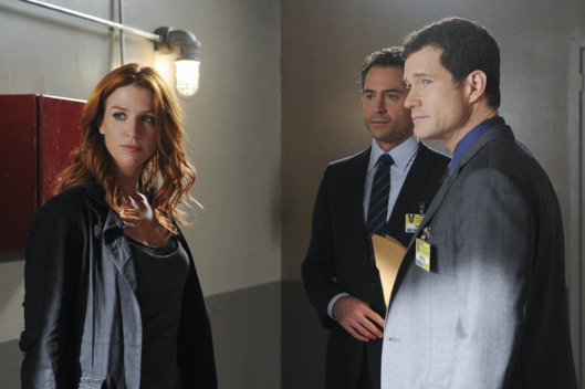 """Check Out Time"" --ADA Adam Gilroy (Omar Metwally, center) discusses the case against a suspect in the murder of a hotel guest with Detectives Carrie Wells (Poppy Montgomery) and Al Burns (Dylan Walsh, right), on UNFORGETTABLE"